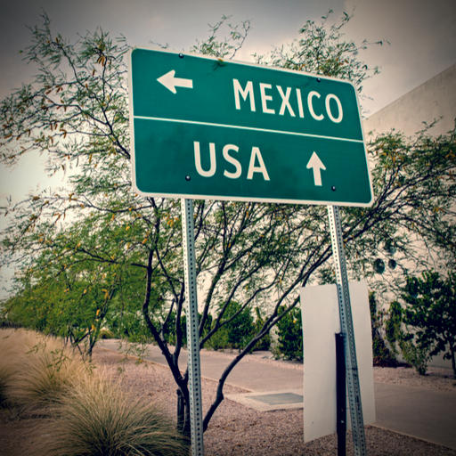 Mexican border image by Chess Ocampo (via Shutterstock).